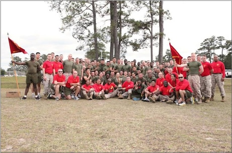 Marines from Financial Management School pose with the 1st place Field Meet trophy.  FMS won the MCCSSS Field Meet Competition held on October 26, 2012.