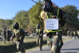 Marines assigned to the Chemical Biological Incident Response Force begin a grueling three-mile run in their protective MOPP gear and gas masks during the second phase of the CBIRF Commander's Challenge on Nov. 6.