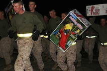 Fort Leonard Wood Marines run with toys they donated to help supports Toys For Tots program.