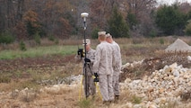 Marines attending the Technical Engineer Course perform practical application utilizing survey equipment.