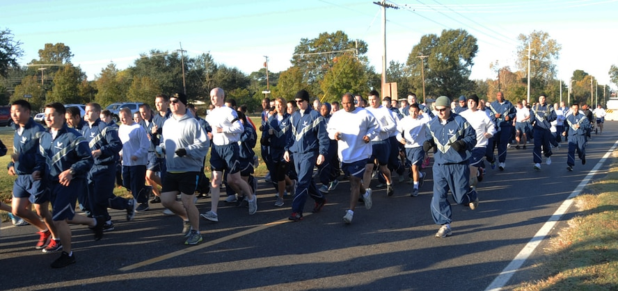 Team Barksdale participates in a 5K Fun Run as part of Sports Day 2012 on Barksdale Air Force Base, La., Nov. 16. Sports Day consists of various team events including dodgeball, basketball, soccer, tug-of-war, volleyball, a homerun derby, flag football and racquetball. This day was designed to improve team work and help increase the awareness of fitness, sports programs and boost morale. (U.S. Air Force photo/Senior Airman Sean Martin)(RELEASED)