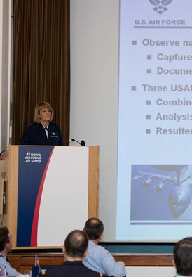 Maj. Gen. Margaret H. Woodward explains proactive aviation safety, identifying precursors to prevent the next mishap, at the International Air Safety Symposium held Nov. 7-8 at Royal Air Force Cranwell, U.K., attended by more than 100 military aviation safety specialists from around the globe. (Courtesy photo)