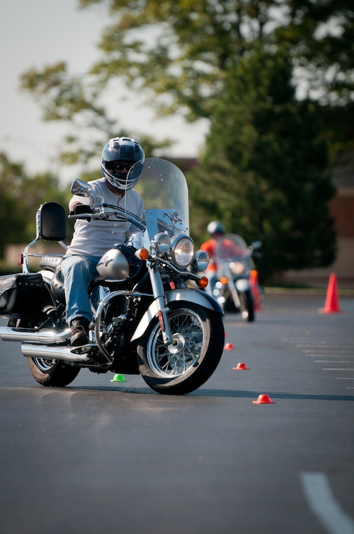 Kentucky Air National Guard Lt. Col. Armand Bolotte, 123rd Logistics Readiness Squadron operations officer, weaves in out of cones during a motorcycle safety train-the-trainer course at the Kentucky Air National Guard Base in Louisville, Ky., on Aug. 23, 2012. The course, part of the Motorcycle Safety Foundation's RiderCoach Program, was designed in part to train student instructors so they can go on to teach motorcycle safety to other service members. (Kentucky Air National Guard photo by Master Sgt. Phil Speck)
