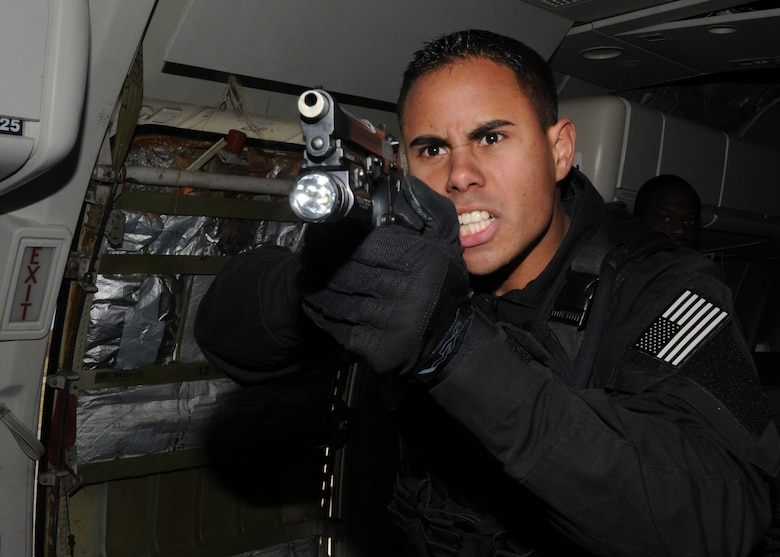 Senior Airman Gabriell Vieira, 11th Security Forces Squadron elite guardsman and Andrews Emergency Services Team member, takes control of his sector of responsibility during an anti-hijacking exercise conducted Nov. 9, 2012, at the Joint Training Facility at Baltimore Washington International Airport, Md. The exercise was a joint effort between the Andrews Emergency Services Team and the Raven team where they practiced tubular assaults during a mock hijacking scenario. (U.S. Air Force photo/ Senior Airman Bahja J. Jones)