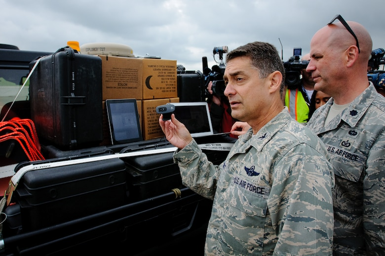 Col. Warren Hurst, commander of the Kentucky Air National Guard's 123rd Contingency Response Group, provides simulated civilian and military leadership with a live video feed of ground conditions at Campbell Army Airfield during an earthquake-response exercise May 14, 2012, at Fort Campbell, Ky. The event marked the first time that disaster-response forces have provided live video to national leaders within hours of a catastrophic event. (U.S. Air Force photo by Senior Airman Maxwell Rechel)