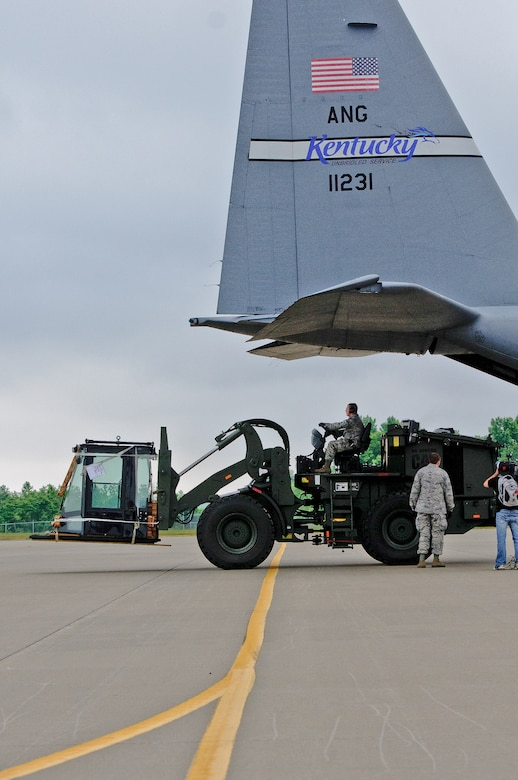 Members of the Kentucky Air National Guard unload a forklift from a C-130 aircraft during an earthquake-response exercise May 14, 2012, at Fort Campbell, Ky. About 20 Airmen from the 123rd Contingency Response Group and 123rd Special Tactics Squadron deployed to demonstrate their preparedness for an initial response after a natural disaster. The Kentucky Air Guard's Initial Response Hub team is the first of its kind in the nation. No other unit in the U.S. military has the same breadth of capabilities housed in one unit, with the C-130 aircraft to permit immediate response. (U.S. Air Force photo by Senior Airman Maxwell Rechel)