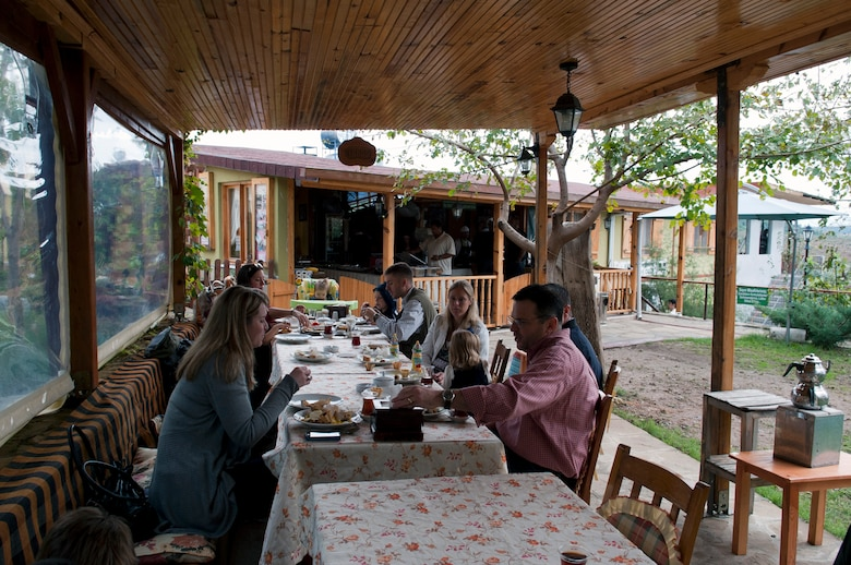 Team Incirlik members have breakfast at Ekotepe Organic Farm Nov. 11, 2012 near Adana, Turkey. Ekotepe is an organic farm about 30 minutes north of Adana that sits on top of a hill and is surrounded by the beautiful Turkish country side. (U.S. Air Force photo by Senior Airman Daniel Phelps/Released)