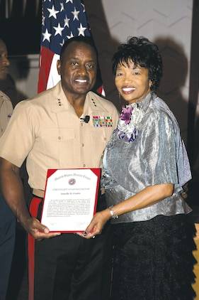 Lt. Gen. Willie Williams, director, Marine Corps Staff, Washington, D.C., stands with Jonelle Cooks after her recent retirement at the Base Chapel.