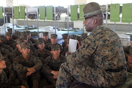 Staff Sgt. Antoine Griffith, senior drill instructor, Platoon 1031, Company B, gives some pointers to his recruits prior to a series commander inspection aboard Marine Corps Recruit Depot San Diego, Nov. 1. Griffith said he tries to teach his recruits how to be proficient Marines.