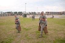 134th Air Refueling Wing Command Chief Master Sgt. Steve Payne and Chaplain (Capt.) Derrick Wakefield carry sand bags to harden facilities while in Mission Orented Protective Posture Ready configuration at The Air National Guard Combat Readiness Training Center, Gulfport MS on February 8, 2012. The 134th ARW performed an Operational Readiness Exercise February 8-12, 2012 in Gulfport