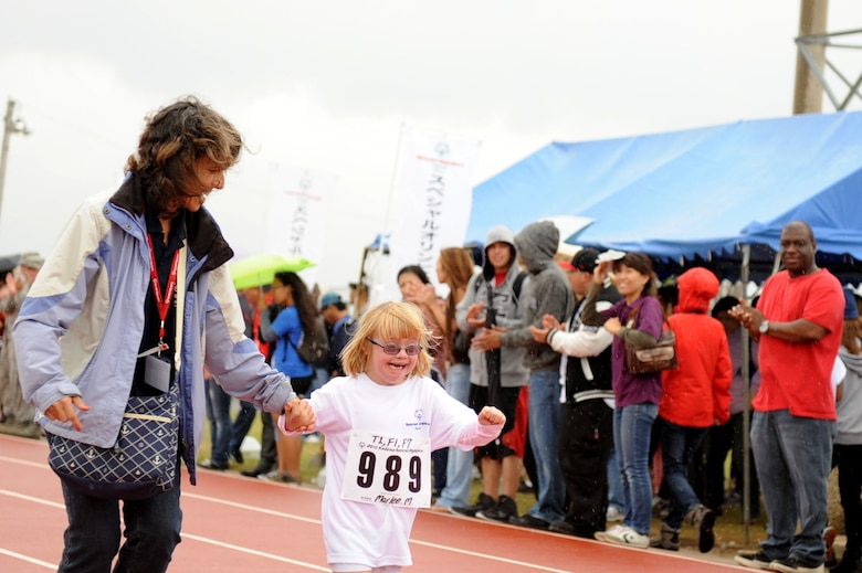 Marlee McDaniel, daughter of U.S. Air Force Col. Brain McDaniel, 18th Wing vice commander, runs the 30 meter dash for her fist event at the Kadena Special Olympics on Kadena Air Base, Japan, Nov. 17, 2012. Marlee is participating in KSO for the first time this year and also participated in the 30 meter dash, and softball throw. (U.S. Air Force photo/Airman 1st Class Brooke P. Beers)