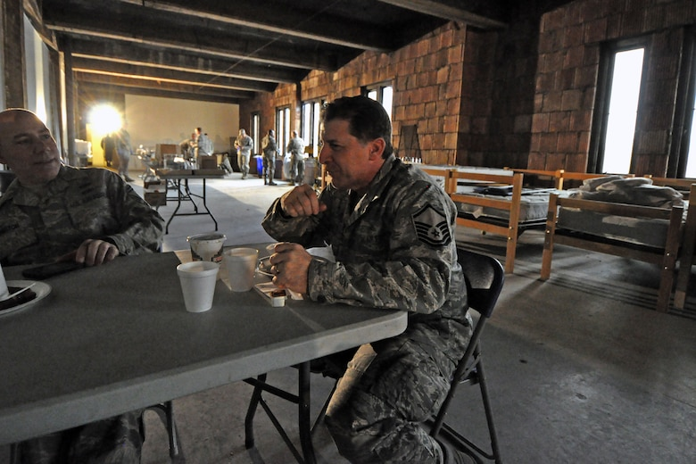 Master Sgt. Steven Sabato, 108th Wing, New Jersey Air National Guard, takes a small break from his duties at the shelter location in Jersey City, Nov. 7 to eat some breakfast. The New Jersey National Guard is providing sheltering for displaced Jersey City residents at the Jersey City armory in the aftermath of Hurricane Sandy. (U.S. Air Force photo by Staff Sgt. Armando Vasquez/Released)