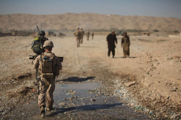 Marines with Golf Company, 2nd Battalion, 7th Marine Regiment, patrol through the construction site during Operation Golden Gate in Sangin, Afghanistan, Nov. 10, 2012. Golf Co. is tasked with providing security for the entire construction site along the Helmand River for the duration of the construction project.