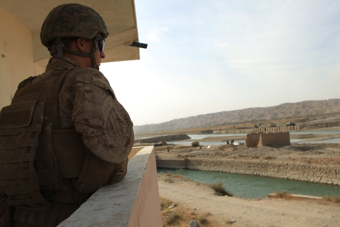 Lance Cpl. Michael Elliott, a rifleman with Golf Company, 2nd Battalion, 7th Marine Regiment, monitors the construction area during Operation Golden Gate, Nov. 14, 2012. Taking place in the Sangin district of Afghanistan, Operation Golden Gate will unite Sangin and Musa Qal'ah with a bridge that will span across the Helmand River.
