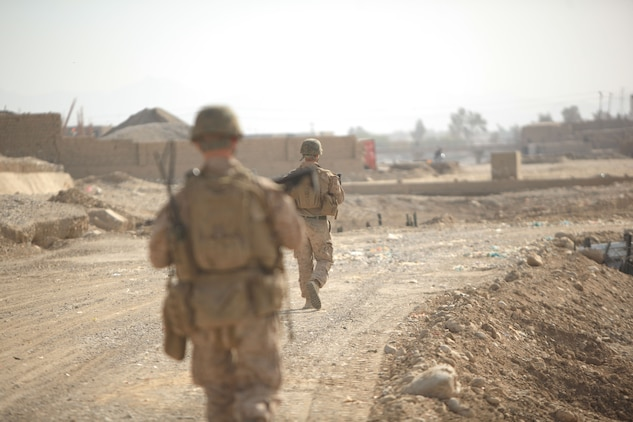 Marines with Golf Company, 2nd Battalion, 7th Marine Regiment, conduct a routine patrol during Operation Golden Gate in Sangin, Afghanistan, Nov. 14, 2012. With a constant presence in the area, the Marines are tasked with the security of the construction site for the duration of the operation.