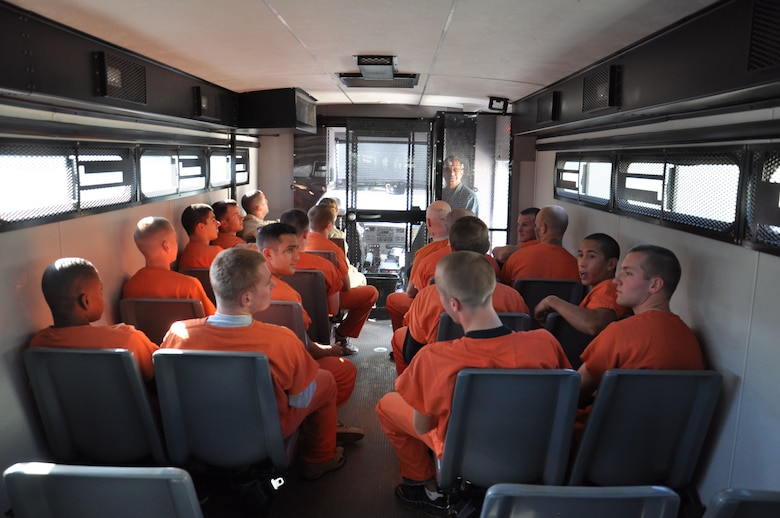 Volunteers from the Laughlin Air Force Base, Texas, dressed as prisoners, ride in a Val Verde County, Texas Sheriff's Department prison bus for a prison riot exercise.  The live exercise was designed to give the guards and medical staff hands-on training as if a real prison incident had occurred. (U.S. Air Force Photo/2nd Lt. David Tart)