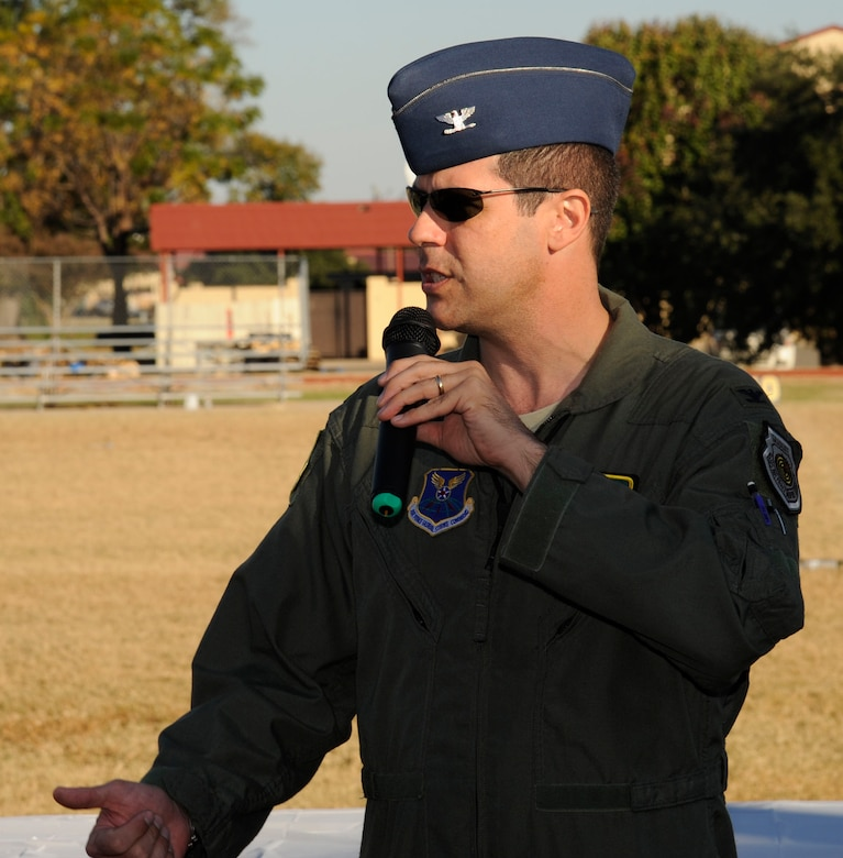 Col. Andrew Gebara, 2nd Bomb Wing commander, addresses members of Team Barksdale during the closing ceremony of the 2012 Sports Day on Barksdale Air Force Base, La., Nov. 16. Sports Day is comprised of various competitive athletic events to help promote physical fitness,health and wellness. (U.S. Air Force photo/Airman 1st Class Andrew Moua)(RELEASED)