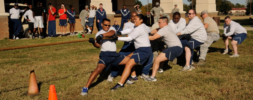 Team Barksdale members participate in a game of tug-of-war during the 2012 Sports Day on Barksdale Air Force Base, La., Nov. 16. Sports Day was designed to improve teamwork and promote the Air Force's Fit-to-Fight mission. (U.S. Air Force photo/Airman 1st Class Andrew Moua)(RELEASED)