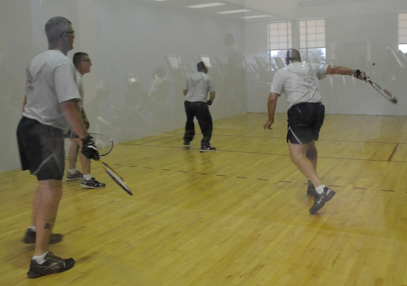 Barksdale Airmen play a game of racquetball during the 2012 Sports Day on Barksdale Air Force Base, La., Nov. 16. Airmen participated in activities such as dodgeball, soccer, basketball, a rucksack relay race, volleyball, flag football and a homerun derby. Sports Day served as a way to promote the importance of fitness and build camaraderie. (U.S. Air Force photo/Airman 1st Class Andrew Moua)(RELEASED)