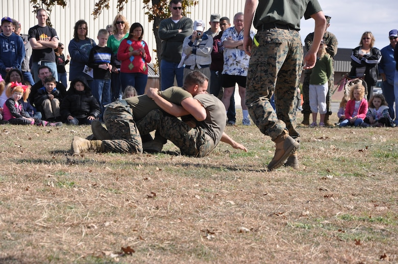 GOODFELLOW AIR FORCE BASE, Texas- Marines from the Marine Corps Detachment demonstrate military martial arts for the public at the Community Appreciation Day and the 32nd Annual Santa's Market event at the Louis F. Garland Fire Academy here Nov. 17. The event was open to the public for free and featured many demonstrations and vendors. (U.S. Air Force photo/ Airman 1st Class Erica Rodriguez)