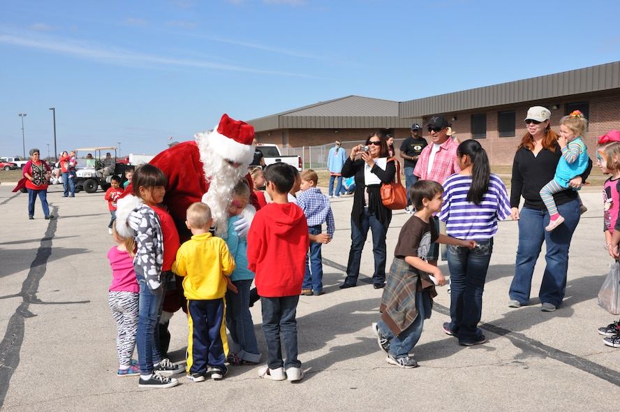 GOODFELLOW AIR FORCE BASE, Texas- Santa Claus visits with children at the Community Appreciation and 32nd Annual Santa's Market event at the Louis F. Garland Fire Academy here Nov. 17. The event was open to the public for free and featured many demonstrations and vendors. (U.S. Air Force photo/ Airman 1st Class Erica Rodriguez)