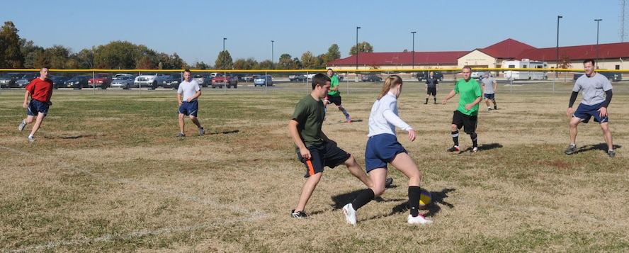 Members of the 2nd Operational Weather Squadron and 2nd Aircraft Maintenance Squadron play soccer during the 2012 Sports Day on Barksdale Air Force Base, La., Nov. 16. Sports Day consists of various team events including dodgeball, basketball, soccer, tug-of-war, volleyball, a homerun derby, flag football and racquetball. This day was designed to improve team work and help increase the awareness of fitness, sports programs and boost morale. (U.S. Air Force photo/ Senior Airman Kristin High)(RELEASED)