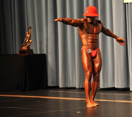 U.S. Air Force Master Sgt. LaJuan Fuller, 366th Civil Engineer Squadron first sergeant, performs his routine during the evening portion of a body building competition April 28, 2012, in Boise, Idaho. Fuller's wife, two sons and friends came out to watch the evening performance where the competitors chose a song and showed off different poses throughout the performance. (U.S. Air Force photo/Airman 1st Class Heather Hayward)