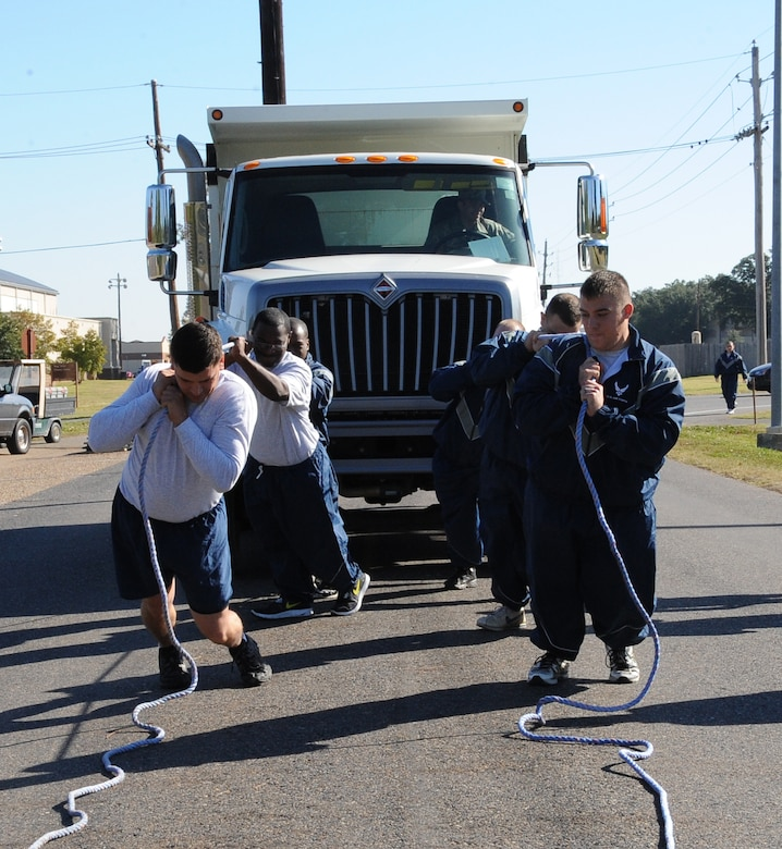 Airmen from the 2nd Civil Engineer Squadron pull a dump truck during the 2012 Sports Day on Barksdale Air Force Base, La., Nov. 16. The annual event gave Airmen the opportunity to participate in several individual and team sports throughout the day boosting morale. (U.S. Air Force photo/Airman 1st Class Benjamin Gonsier)(RELEASED)