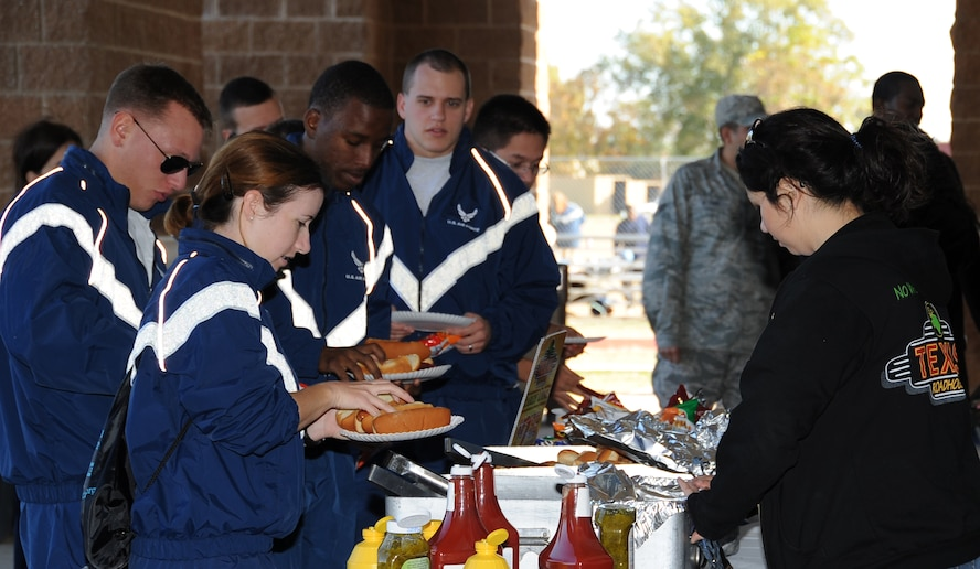 Airmen receive food from a local vendor during the 2012 Sports Day on Barksdale Air Force Base, La., Nov. 16. Local vendors contributed to Sports Day by providing Airmen food and beverages. (U.S. Air Force photo/Airman 1st Class Benjamin Gonsier)(RELEASED)