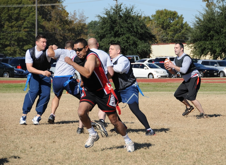 Barksdale Airmen participate in a flag football game during the 2012 Sports Day on Barksdale Air Force Base, La., Nov. 16. Sports Day gave Airmen the opportunity to compete against other squadrons in friendly competition to build teamwork and increase the awareness of fitness. (U.S. Air Force photo/Airman 1st Class Benjamin Gonsier)(RELEASED)