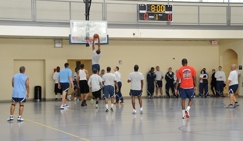 Senior Airman Micaiah Anthony, 2nd Bomb Wing Public Affairs photographer, dunks a basketball during the 2012 Sports Day on Barksdale Air Force Base, La., Nov. 16. Sports Day gave Airmen the opportunity to compete against other squadrons in friendly competition to build teamwork and increase the awareness of fitness. (U.S. Air Force photo/Airman 1st Class Benjamin Gonsier)(RELEASED)