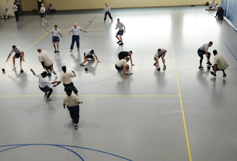 Teams face off in a dodgeball tournament during the 2012 Sports Day on Barksdale Air Force Base, La., Nov. 16. Sports day was designed to improve team work and help increase the awareness of fitness, sports programs and boost morale. (U.S. Air Force photo/Senior Airman Sean Martin)(RELEASED)