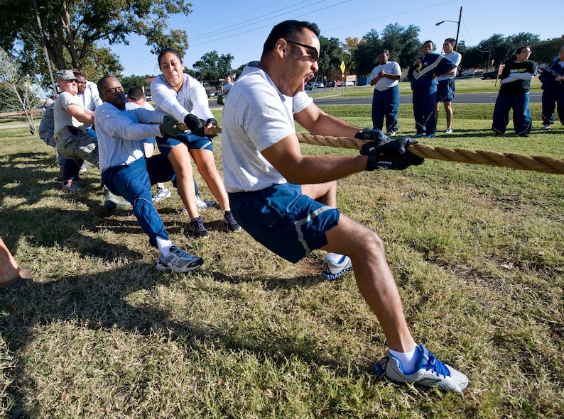 Airmen from the 2nd Communications Squadron compete in a tug-of-war match during the 2012 Sports Day on Barksdale Air Force Base, La., Nov. 16. This annual event gives Airmen the opportunity to participate in several individual and team sports throughout the day boosting team morale. (U.S. Air Force photo/Staff Sgt. Chad Warren)(RELEASED)