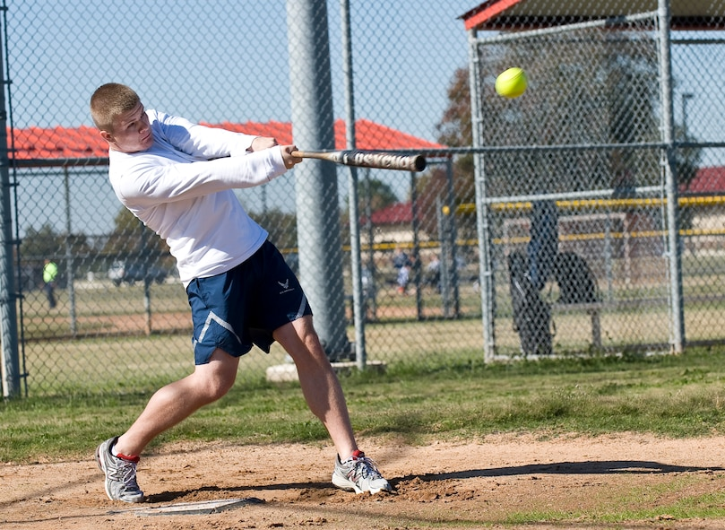 Airman 1st Class Kristopher Tolar, 2nd Contracting Squadron, hits a ball during the homerun derby on Barksdale Air Force Base, La., Nov. 16. The derby was part of the 2012 Sports Day, an annual event that gives Airmen the opportunity to participate in several individual and team sports throughout the day. (U.S. Air Force photo/Staff Sgt. Chad Warren)(RELEASED)