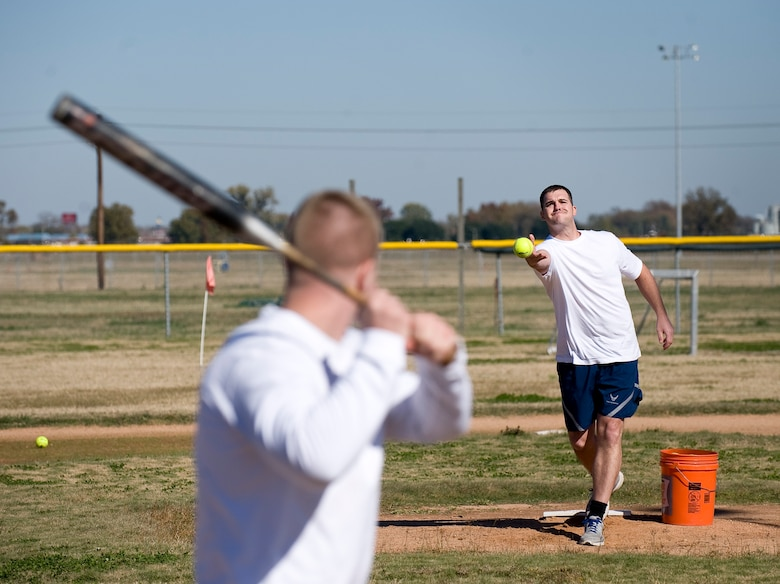 Tech. Sgt. Jason Wilkin, 2nd Contracting Squadron, pitches a ball to Airman 1st Class Kristopher Tolar, 2 CONS, during the homerun derby on Barksdale Air Force Base, La., Nov. 16. The derby was part of the 2012 Sports Day, an annual event that gives Airmen the opportunity to participate in several individual and team sports throughout the day. (U.S. Air Force photo/Staff Sgt. Chad Warren)(RELEASED)