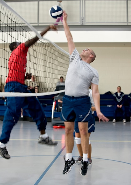 Airmen battle for a point during a volleyball match on Barkdale Air Force Base, La., Nov. 16. The match was part of the 2012 Sports Day, an annual event that gives Airmen the opportunity to participate in several individual and team sports throughout the day focusing on teamwork and boosting morale. (U.S. Air Force photo/Staff Sgt. Chad Warren)(RELEASED)