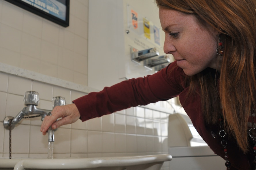 Kelly Sussman, 35th Civil Engineer Squadron volunteer, checks a faucet for its low flow aerator at Misawa Air Base, Japan, Nov. 15, 2012. Low flow aerators can save up to 13,000 gallons of water, which equates to savings of $100 per year.  (U.S. Air Force photo by Tech. Sgt. Phillip Butterfield)