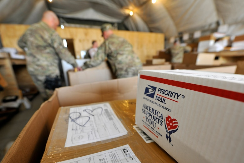 Airmen of the 455th Expeditionary Knowledge Operations Management office sort boxes and envelopes for personnel at Bagram Airfield, Afghanistan, Nov. 15, 2012.  Members of the KOM office dedicate themselves, day-in and day-out, to provide an appreciated service to 455th Air Expeditionary Wing by keeping the mail flowing. (U.S. Air Force photo/Senior Airman Chris Willis)