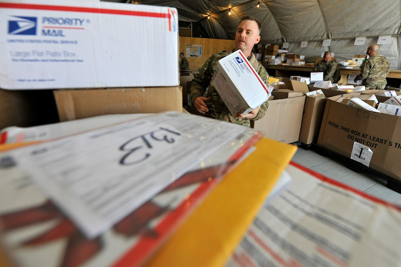 Tech. Sgt. Shawn McCowan, a member of the 455th Air Expeditionary Wing Public Affairs, volunteers to sort mail at the postal annex at Bagram Airfield, Afghanistan, Nov. 15, 2012.  Many Airmen from different units volunteer during the holiday season when the in-coming mail nearly doubles for BAF personnel.  (U.S. Air Force photo/Senior Airman Chris Willis)