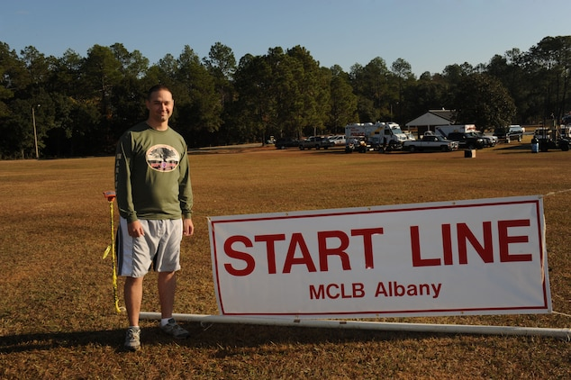 Capt. Kyle Thomas, deputy Public Affairs Officer, Marine Corps Logistics Base Albany, poses at the starting line before beginning the Dirty Devil Dog Mud Run at MCLB Albany, Nov. 17.