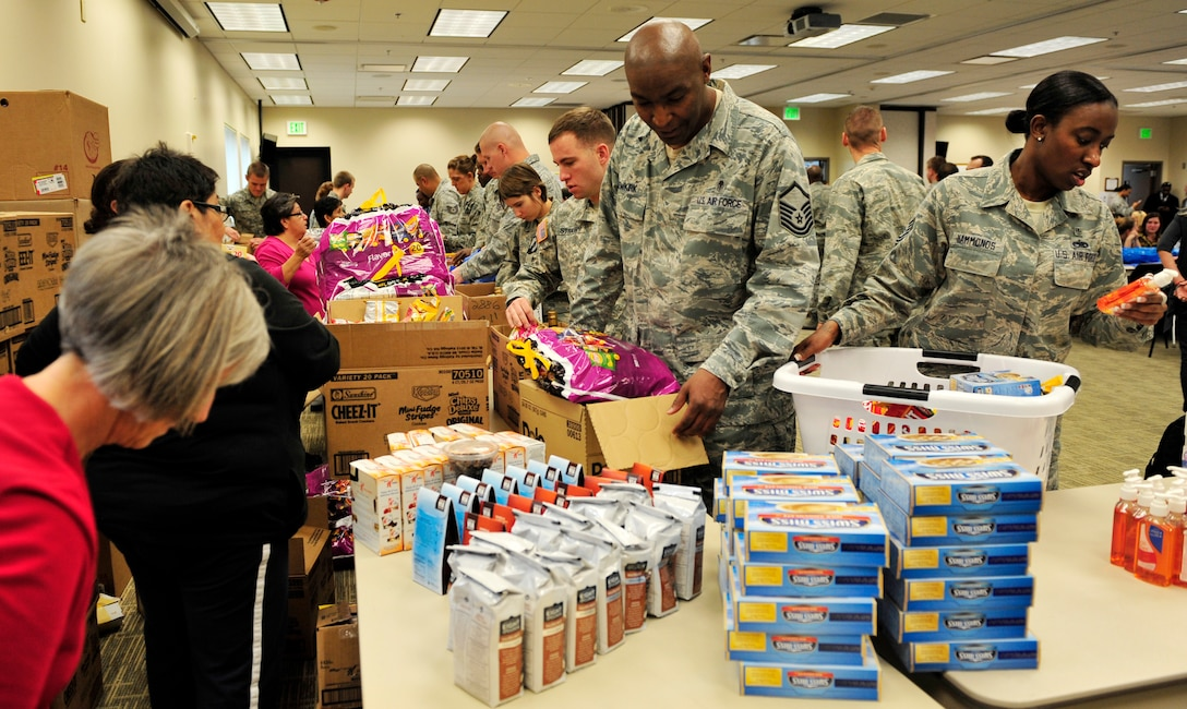 BUCKLEY AIR FORCE BASE, Colo. – Members from Buckley and the Smokey Hill Vineyard Food Bank joined together to bring joy and wellness to military families Nov. 19, 2012, at the base chapel. Thanksgiving is near, so as a result, this food drive gave military families stability during the holidays. (U.S. Air Force photo by Airman 1st Class Darryl Bolden Jr.)