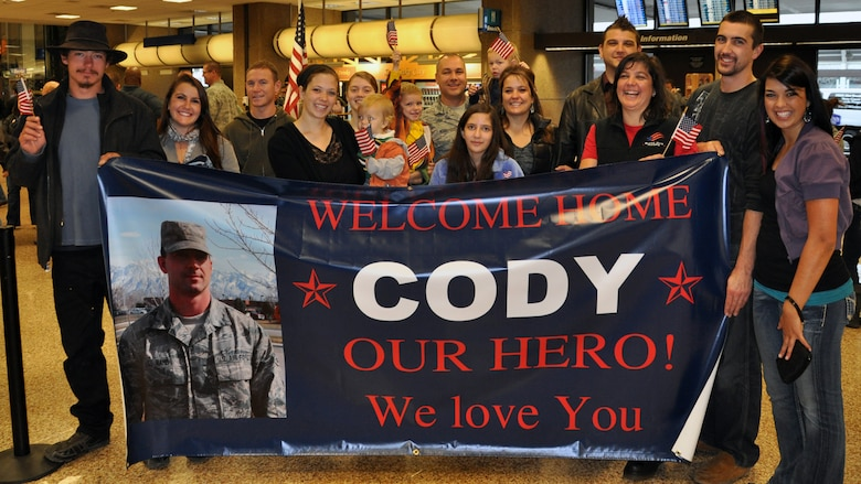 Family and friends waited to welcome home Senior Airman Cody Hard as he returned from deployment at the Salt Lake City International Airport, Nov. 16. Hard and eleven other members of the 130th Engineering Installation Squadron served a six-month deployment in support of Operation Enduring Freedom throughout several forward operating bases in Afghanistan. (U.S. Air Force photo courtesy Staff Sgt. Ashlee Hood)(RELEASED)