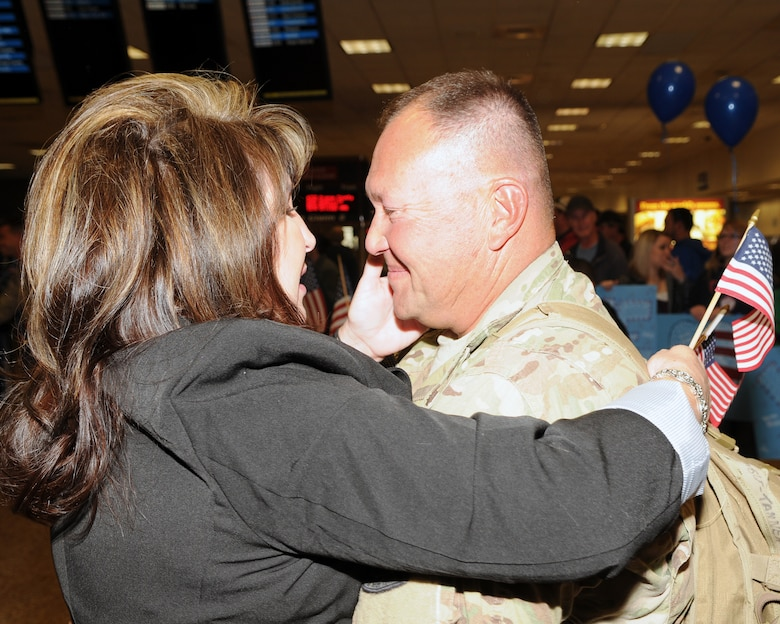 Master Sgt. Vincent Tanner greeted his wife, Roshell, as he returned from deployment at the Salt Lake City International Airport, Nov. 16. Tanner and eleven other members of the 130th Engineering Installation Squadron served a six-month deployment in support of Operation Enduring Freedom throughout several forward operating bases in Afghanistan. (U.S. Air Force photo by Senior Airman Lillian Harnden)(RELEASED)