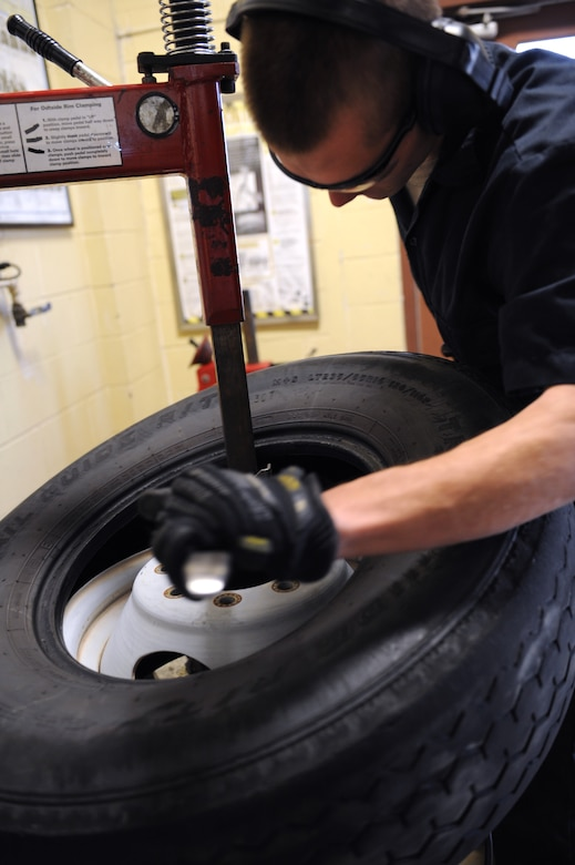 Airman 1st Class Kenneth Bates, 2nd Logistics Readiness Squadron Allied Trades section journeyman, removes a rim from a tire on Barksdale Air Force Base, La., Nov. 19. When a tire is worn out, it is demounted and replaced with a new one. The maintainers at the 2 LRS tire shop repair tires that contain nails, screws and bolts, broken valve stems, tires that have blown out from abnormal use, and wear and tear. They also perform more than 100 tire changes each month. (U.S. Air Force photo/Airman 1st Class Benjamin Gonsier)(RELEASED)