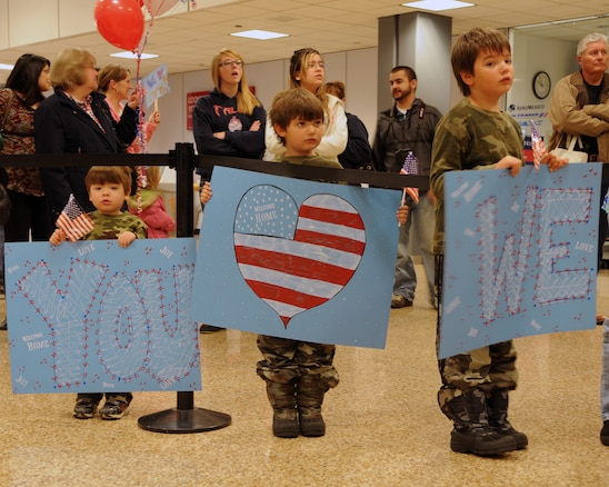 The three sons of Staff Sgt. Christian Ward waited to welcome home their dad as he returned from deployment at the Salt Lake City International Airport, Nov. 16. Ward and eleven other members of the 130th Engineering Installation Squadron served a six-month deployment in support of Operation Enduring Freedom throughout several forward operating bases in Afghanistan. (U.S. Air Force photo by Senior Airman Lillian Harnden)(RELEASED)