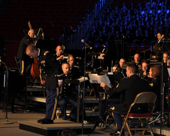"Chief Warrant Officer 2 Denny Saunders takes a bow after conducting the opening number, ""The Footlifter,"" during the Utah National Guard's 57th annual Veterans Day concert at the University of Utah's Jon M. Huntsman Center, Nov. 10. Saunders led the Utah National Guard's 23rd Army Band and a 600-voice combined choir from Granite School District high schools through several numbers during the evening event. (U.S. Air Force photo by Senior Airman Lillian Harnden)(RELEASED)"