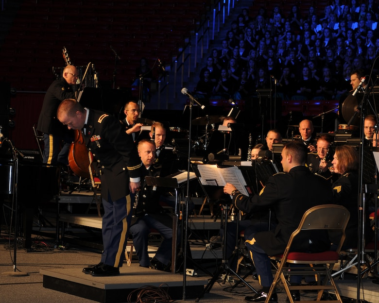 """Chief Warrant Officer 2 Denny Saunders takes a bow after conducting the opening number, """"The Footlifter,"""" during the Utah National Guard's 57th annual Veterans Day concert at the University of Utah's Jon M. Huntsman Center, Nov. 10. Saunders led the Utah National Guard's 23rd Army Band and a 600-voice combined choir from Granite School District high schools through several numbers during the evening event. (U.S. Air Force photo by Senior Airman Lillian Harnden)(RELEASED)"""