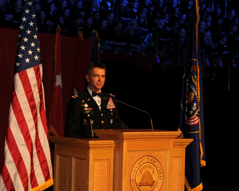 Guest speaker Maj. Gen. Jefferson Burton, the Adjutant General of the Utah National Guard, addressed the audience during the 57th annual Veterans Day concert at the University of Utah's Jon M. Huntsman Center, on Nov. 10. Burton dedicated the night's performance to veterans who served in the past, and to veterans who are currently in harm's way. (U.S. Air Force photo by Senior Airman Lillian Harnden)(RELEASED)