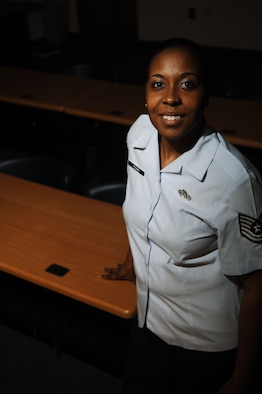 Tech Sgt. Kimberly Young, 633rd Air Base Wing Safety noncommissioned officer in charge, poses for a photo at Langley Air Force Base, Va., Nov. 19, 2012.  Although Young has won numerous awards after being in safety just three years, she says the recognition is not a factor in why she loves teaching defensive driving. (U.S. Air Force photo by Staff Sgt. Katie Gar Ward / Released)