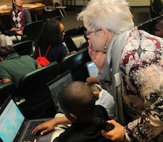 Beverly Richey, geographer and GIS specialist at Huntsville Center, helps a sixth-grader at Ed White Middle School use an online map Nov. 14 durin
